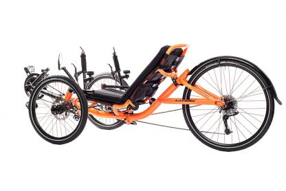 Side, left at 45 degree view of Catrike 5.5.9 recumbent trike in atomic orange