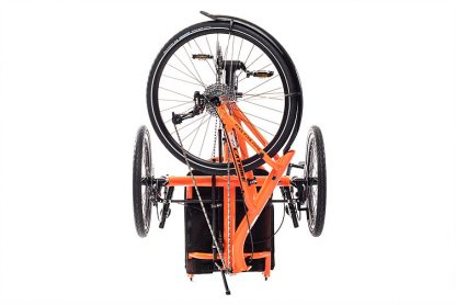 Rear, folded view of Catrike 5.5.9 recumbent trike in atomic orange for easy transport