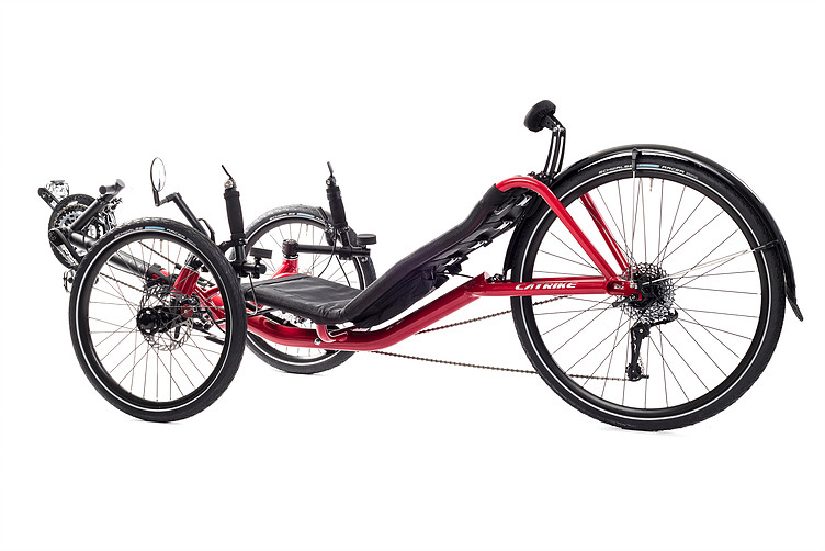 Side, left 45 degree view of Catrike Expedition recumbent trike in lava red color