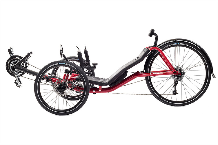 Side, left view of Catrike Expedition recumbent trike in lava red color