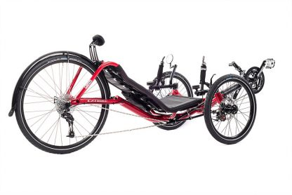 Side, right 45 degree view of Catrike Expedition recumbent trike in lava red color