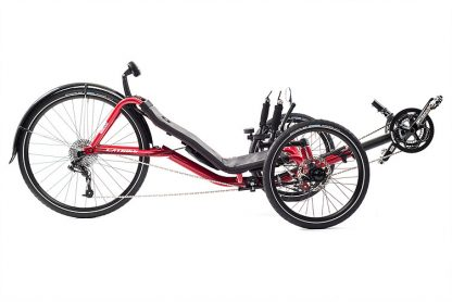 Side, right view of Catrike Expedition recumbent trike in lava red color