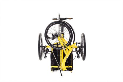 Side view of folded, Catrike trail recumbent trike in firefly yellow for easy transport