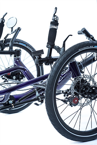 Closeup view of front suspension for a Catrike Dumont Candy Purple fully suspended recument trike