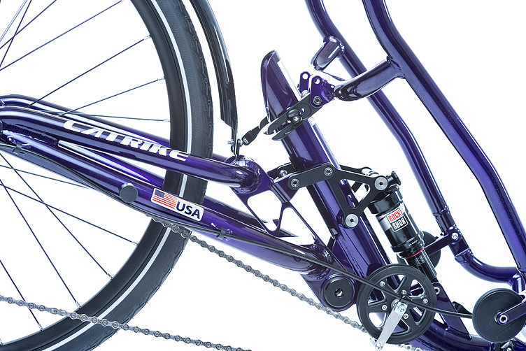 Closeup view of rear suspension for a Catrike Dumont Candy Purple fully suspended recument trike
