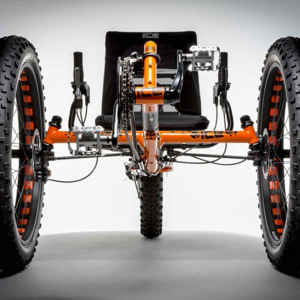 Front view of an orange, ICE Full Fat Tire Recumbent Trike