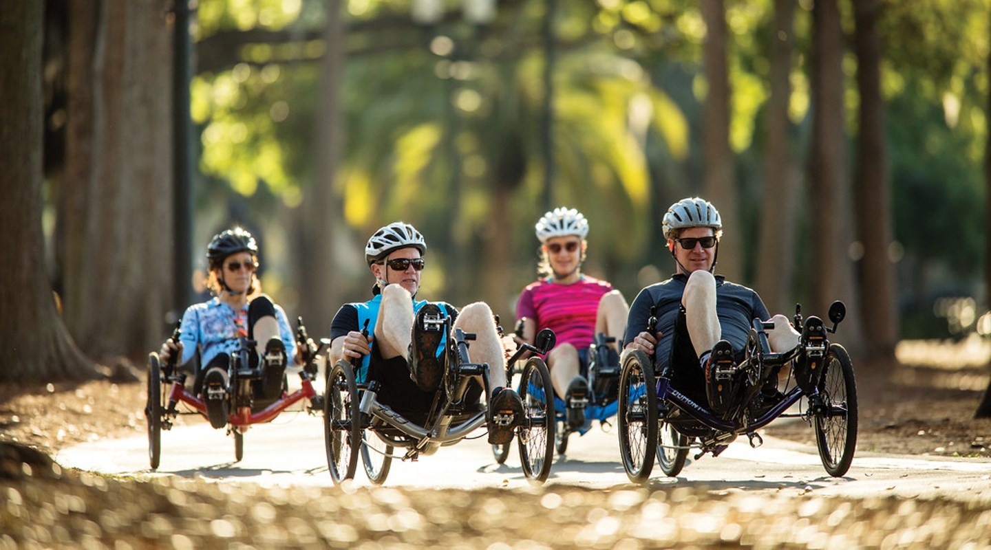 recumbent trike riders on trail smiling